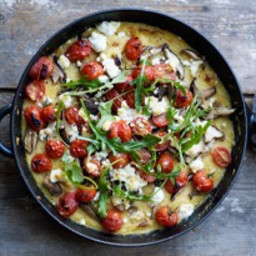 Polenta bake with tomato, feta, and mushrooms