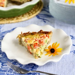 Potato-Crusted Vegetarian Quiche Recipe with Zucchini, Tomatoes  and  Feta