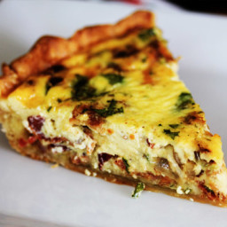 Quiche lorraine with shallots in a bed of emmental