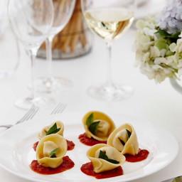 Ricotta parmesan tortellini with tomato sugo and basil