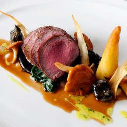 Roasted loin of New Forest venison with snails, roasted chervil root and a