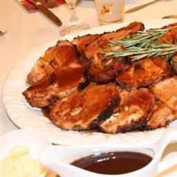 Rosemary-Scented Pork Loin Stuffed With Roasted Garlic, Dried Apricots and