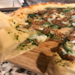 sausage-and-kale-pesto-pizza-with-blistered-tomato-arugula-salad-543c4052f95633e18fcf4510.jpg