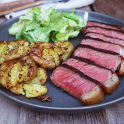 Seared Wagyu Strip Steak with Truffled Smashed Potatoes