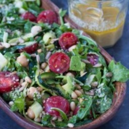 shaved zucchini and arugula salad with pine nut lemon dressing