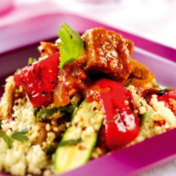 Slow Roasted glazed lamb served with jewelled couscous