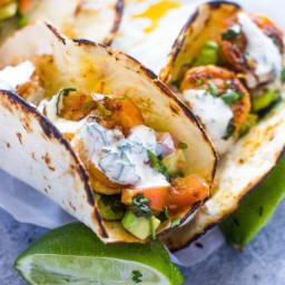 spicy-shrimp-tacos-with-avocado-salsa-and-sour-cream-cilantro-sauce-1665603.jpg
