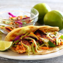 Spicy Tilapia Baja Tacos with Lime Slaw and Avocado Cilantro Sauce
