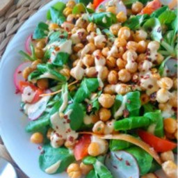SPINACH AND RADISH SALAD WITH ROASTED CHICKPEAS AND TAHINI DRESSING