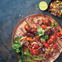 Steak kebabs with an onion, corn and sun-dried tomato salsa