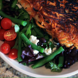 SWEET POTATO CRUSTED FISH OVER GREENS WITH LIME GARLIC DRESSING
