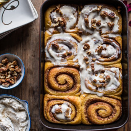 Sweet Potato Pie Cinnamon Rolls with Butter Whipped Meringue Frosting.