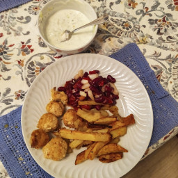 Tasty and healthy chicken nuggets, french fries, bean salad with tzatziki