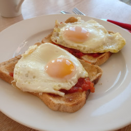 Tomato baked eggs on a toast