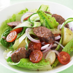 Warm sausage salad with pepper dressing