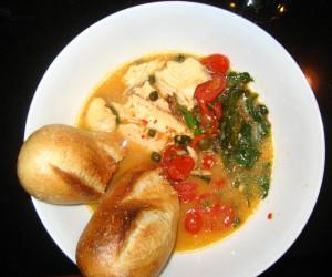 Tilapia with arugula and lemony tomato sauce